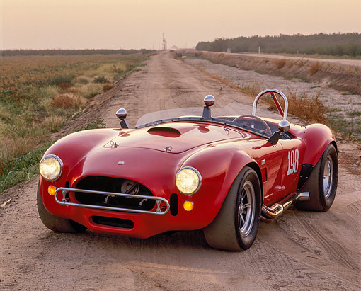 COB 01 RK0076 03 © Kimball Stock 1966 AC Shelby Cobra Race Car Red 3/4 Front View On Dirt Road At Dusk