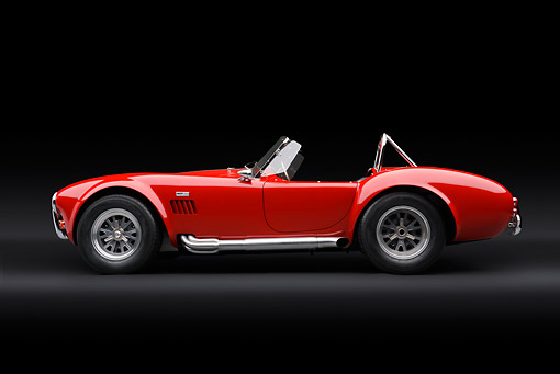 COB 01 RK0143 01 © Kimball Stock 1966 Shelby AC Cobra Red With White Stripes Profile View In Studio