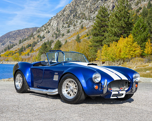 COB 01 RK0152 01 © Kimball Stock 1965 Cobra Replica Blue With White Stripes 3/4 Front View By Lake And Mountain