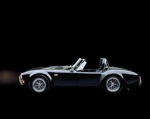 COB 01 RK0033 04 © Kimball Stock 1965 Ford Shelby AC Cobra Convertible Black Profile View Studio