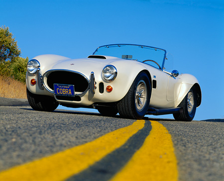 COB 01 RK0054 01 © Kimball Stock 1966 AC Shelby Cobra 427 Convertible Low 3/4 Front View On Pavement Blue Sky