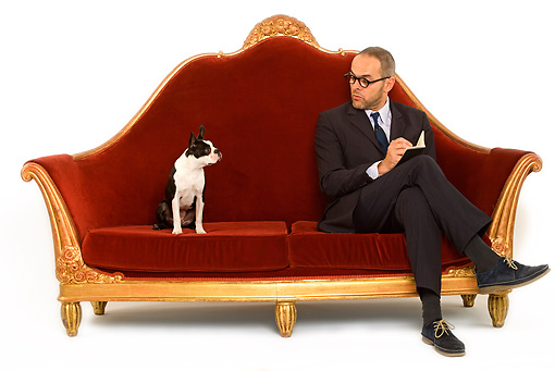 DOG 02 JE0052 01 © Kimball Stock Boston Terrier Sitting On Red Sofa With Psychiatrist On White Seamless