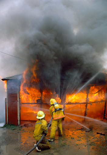 FIR 01 RK0001 12 © Kimball Stock Fireman Fighting Fire