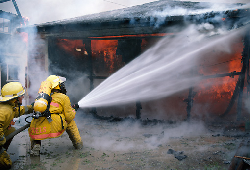 FIR 01 RK0001 06 © Kimball Stock Fireman Fighting Fire