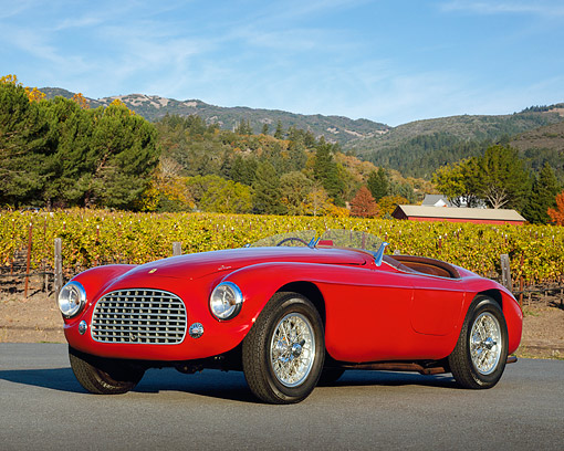 FRR 03 RK0005 06 © Kimball Stock 1950 Ferrari 166 MM Touring Barchetta Red 3/4 Front View On Pavement By Vineyard
