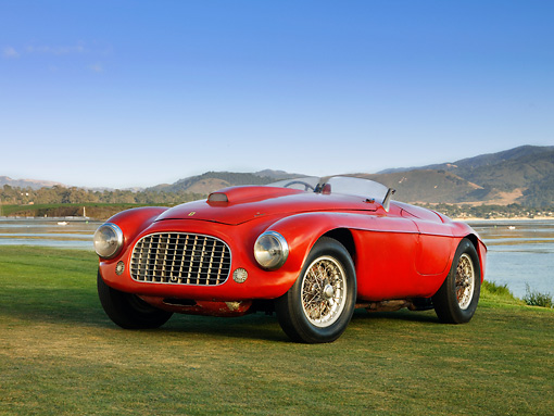FRR 03 RK0119 01 © Kimball Stock 1950 Ferrari 166 MM Touring  Barchetta Red Front 3/4 View On Grass By Water Mountains Sky