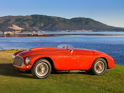 FRR 03 RK0120 01 © Kimball Stock 1950 Ferrari 166 MM Touring  Barchetta Red Front 3/4 View On Grass By Water Mountains Sky
