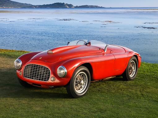 FRR 03 RK0121 01 © Kimball Stock 1950 Ferrari 166 MM Touring  Barchetta Red Front 3/4 View On Grass By Water Mountains Sky