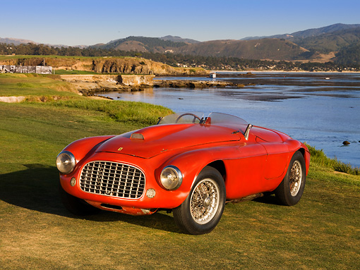 FRR 03 RK0122 01 © Kimball Stock 1950 Ferrari 166 MM Touring  Barchetta Red Front 3/4 View On Grass By Water Mountains Sky