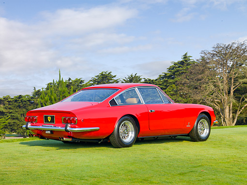 FRR 04 BK0003 01 © Kimball Stock 1970 Ferrari 365 GT 2+2 Red 3/4 Rear View On Grass By Trees