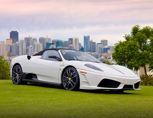 FRR 04 BK0004 01 © Kimball Stock Ferrari F430 16M Scuderia White 3/4 Front View On Grass By City Skyline