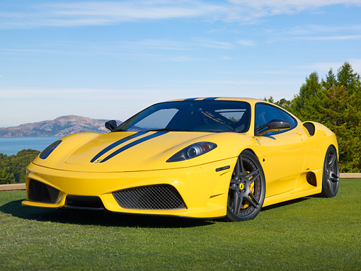 FRR 04 BK0006 01 © Kimball Stock 2010 Novitec Rosso Ferrari F430 Scuderia Yellow 3/4 Front View On Grass By Lake