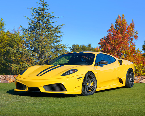FRR 04 BK0009 01 © Kimball Stock 2010 Novitec Rosso Ferrari F430 Scuderia Yellow 3/4 Front View On Grass By Autumn Leaves
