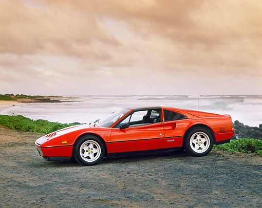FRR 04 RK0047 04 © Kimball Stock 1985 Ferrari 328 GT Red  3/4 Front View On Sand By Beach