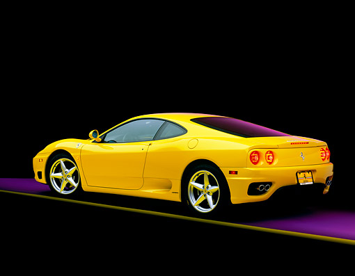 FRR 04 RK0165 02 © Kimball Stock 1999 Ferrari 360 Modena Yellow 3/4 Rear View On  Gray Line Studio