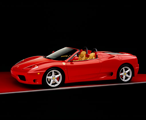 FRR 04 RK0281 01 © Kimball Stock 2002 Ferrari 360 Modena F1 Spyder Red 3/4 Side View On Red Floor Studio
