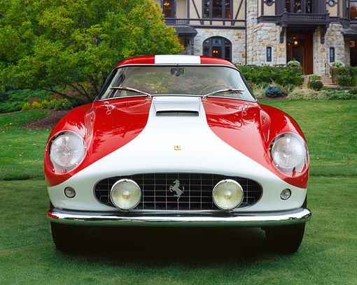 FRR 04 RK0355 04 © Kimball Stock 1955 Ferrari 250GT TDF Red And White Front View On Grass By Mansion