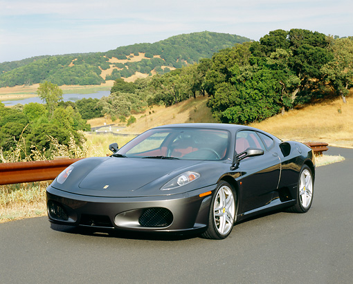 FRR 04 RK0378 01 © Kimball Stock 2005 Ferrari F430 Grigio Silverstone 3/4 Front View On Pavement By Hills And Trees