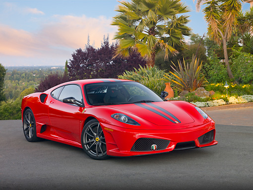 FRR 04 RK0629 01 © Kimball Stock 2009 Ferrari F430 Scuderia Red 3/4 Front View On Pavement By House And Trees