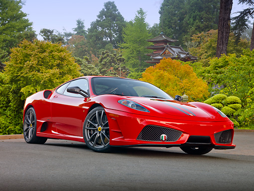 FRR 04 RK0634 01 © Kimball Stock 2009 Ferrari F430 Scuderia Red 3/4 Front View On Pavement By House And Trees