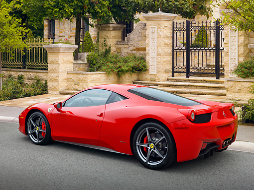 FRR 04 RK0654 01 © Kimball Stock 2011 Ferrari 458 Italia Red 3/4 Rear View On Pavement By Gate And Trees
