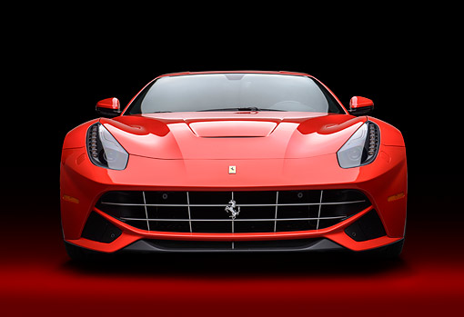 FRR 04 RK0710 01 © Kimball Stock 2014 Ferrari F-12 Berlinetta Red Front View In Studio