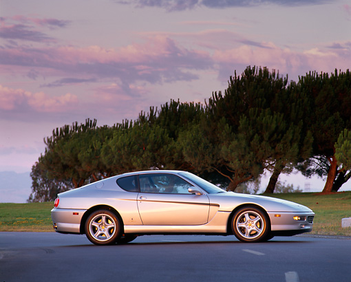 FRR 04 RK0006 03 © Kimball Stock 1994 Ferrari 456 GT Silver 3/4 Front View On Pavement Trees Background