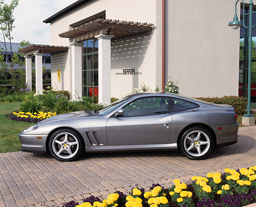 FRR 04 RK0025 01 © Kimball Stock 1997 Ferrari 550 Silver Profile View By Building And Flowers