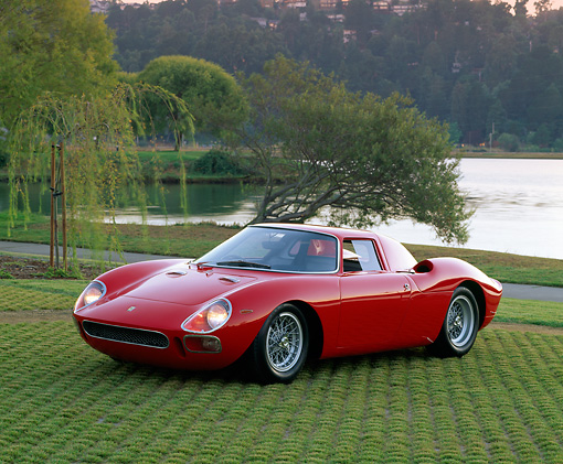 FRR 04 RK0115 02 © Kimball Stock 1965 Ferrari 250 LM Red 3/4 Front View On Grass By Trees And Water