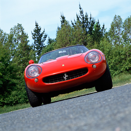 FRR 04 RK0122 06 © Kimball Stock 1967 Ferrari 275 GTB/4 Red Head On View On Pavement By Trees