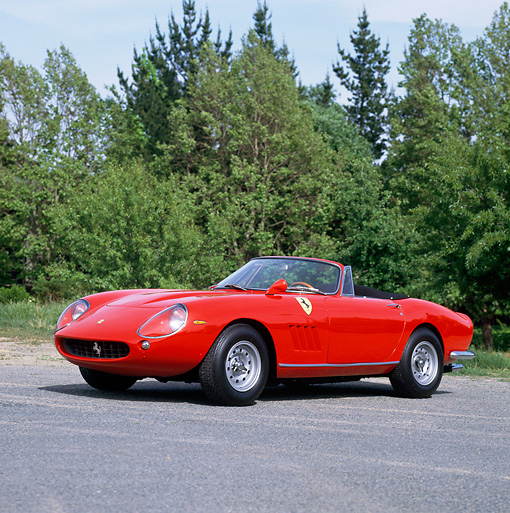 FRR 04 RK0125 08 © Kimball Stock 1967 Ferrari 275 GTB/4 Red 3/4 Front View On Pavement By Trees And Blue Sky