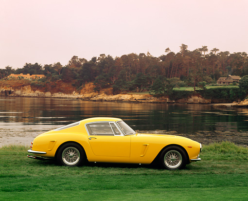 FRR 04 RK0161 03 © Kimball Stock 1960 Ferrari 250 GT SWB Scaglietti Berlinetta Yellow Profile View On Grass By Water