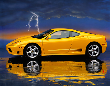 FRR 04 RK0167 06 © Kimball Stock 1999 Ferrari 360 Modena Yellow 3/4 Front On Mylar Floor Lightning Background Studio