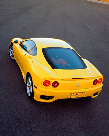 FRR 04 RK0180 05 © Kimball Stock 1999 Ferrari 360 Modena Yellow Overhead 3/4 Rear Shot On Grass