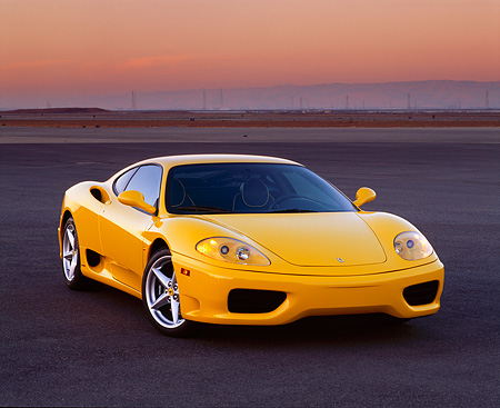 FRR 04 RK0184 03 © Kimball Stock 1999 Ferrari 360 Modena Yellow 3/4 Front View On Pavement At Dusk