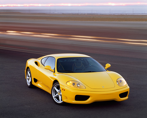 FRR 04 RK0186 01 © Kimball Stock 1999 Ferrari 360 Modena Yellow 3/4 Front View On Pavement