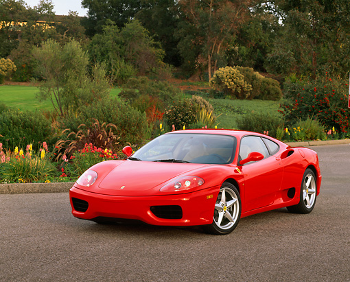 FRR 04 RK0197 01 © Kimball Stock 1999 Ferrari 360 Modena Red Front 3/4 View On Pavement By Flowers And Trees