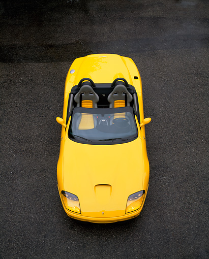 FRR 04 RK0220 06 © Kimball Stock 2001 Ferrari Barchetta Yellow Overhead Front View On Pavement