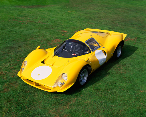 FRR 04 RK0226 03 © Kimball Stock 1963 Ferrari 412 P3 Yellow Overhead 3/4 Front View On Grass