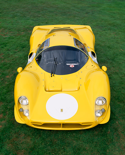 FRR 04 RK0228 01 © Kimball Stock 1963 Ferrari 412 P3 Yellow Overhead Head Shot On Grass Italiano