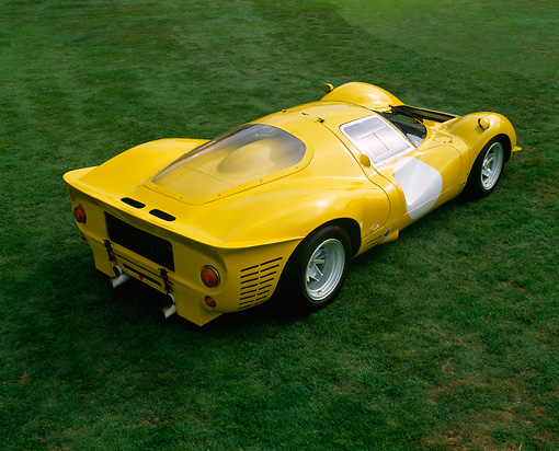 FRR 04 RK0231 01 © Kimball Stock 1963 Ferrari 412 P3 Yellow Overhead 3/4 Rear View On Grass