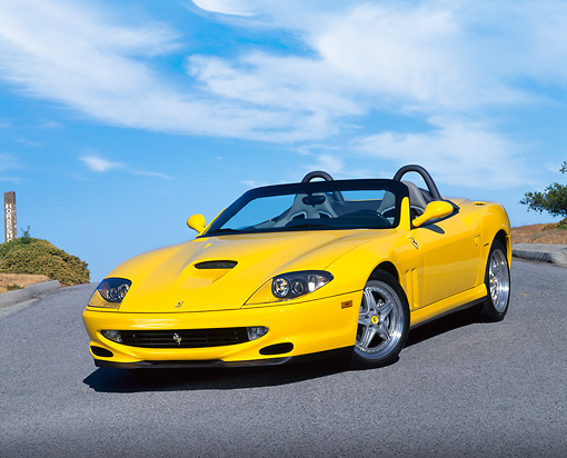 FRR 04 RK0242 07 © Kimball Stock 2001 Ferrari Barchetta Yellow 3/4 Front View On Pavement Hill Blue Sky