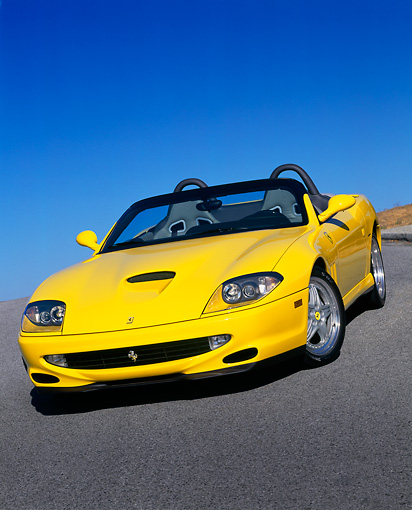 FRR 04 RK0243 02 © Kimball Stock 2001 Ferrari Barchetta Yellow 3/4 Front View On Pavement Hill Blue Sky