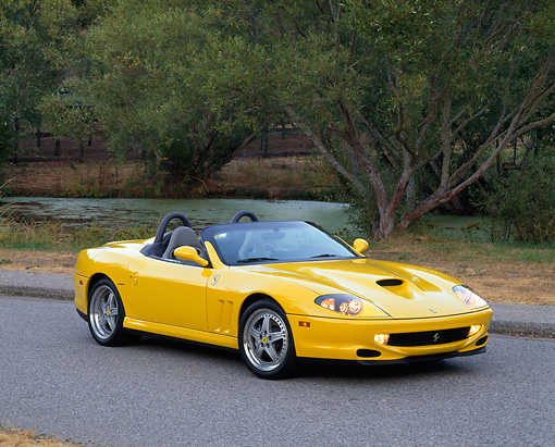 FRR 04 RK0249 02 © Kimball Stock 2001 Ferrari Barchetta Yellow 3/4 Front View On Pavement By Water And Trees