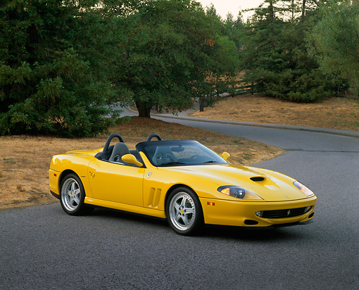 FRR 04 RK0250 04 © Kimball Stock 2001 Ferrari Barchetta Yellow 3/4 Side View On Pavement By Trees