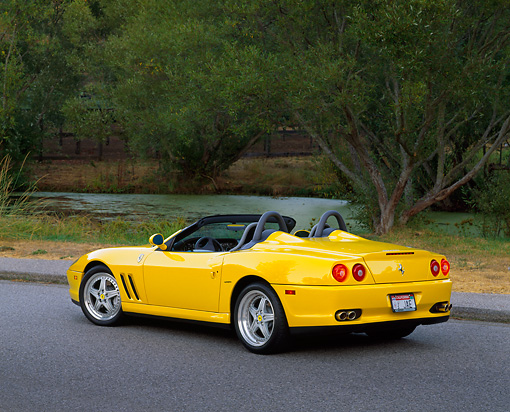FRR 04 RK0252 04 © Kimball Stock 2001 Ferrari Barchetta Yellow 3/4 Rear View On Pavement By Water And Trees