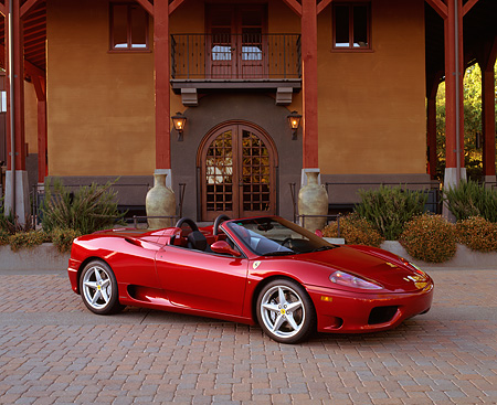 FRR 04 RK0260 02 © Kimball Stock 2001 Ferrari 360 Spider Convertible Red 3/4 Side View In Front Of Building