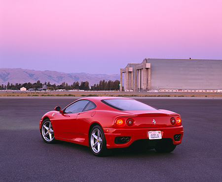 FRR 04 RK0267 01 © Kimball Stock 1999 Ferrari 360 Modena Red Rear 3/4 View On Pavement By Hangar Filtered
