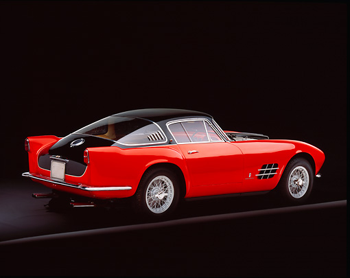 FRR 04 RK0271 01 © Kimball Stock 1955 Ferrari 375mm Sport Competitione Speciale Red And Black 3/4 Rear View On Gray Line Studio