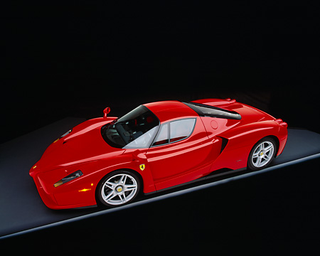 FRR 04 RK0286 15 © Kimball Stock 2003 Ferrari Enzo Red Overhead 3/4 Side View On Gray Line And Floor Studio